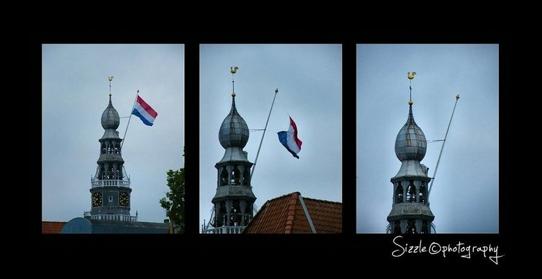 Oeps... en weg was hij. - Vijf mei bevrijdings fetival in VLissingen..Waaide de vlag van de Sint Jacobskerk..Het werd al donker en het begon harder te