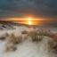 Zonsondergang Banjaard strand