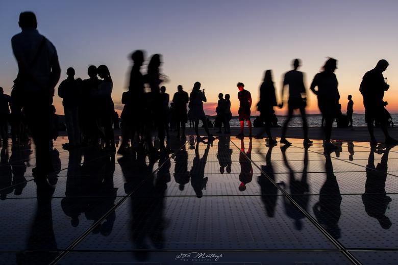 man with the red face - De zonnegroet in Zadar.<br /> Ergens op de dijk in Zadar vind je deze plek. Hier komen de mensen samen om te genieten van de