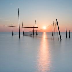 Zonsondergang en Visnetten