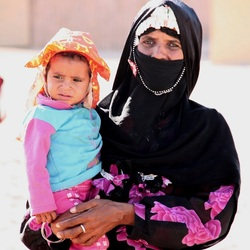 Woman with child in Sahara Desert