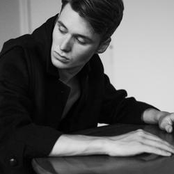 Julien in black coat