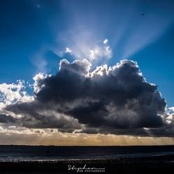 Schitteren achter de wolken