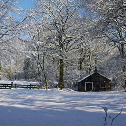 Winterlandschap met huisje