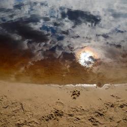 Zon in het water