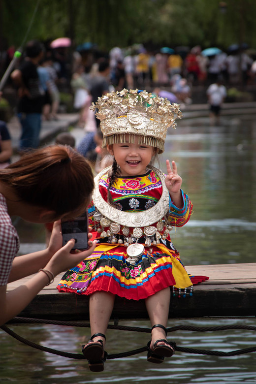 Trotse mama in Fenghuang, China -