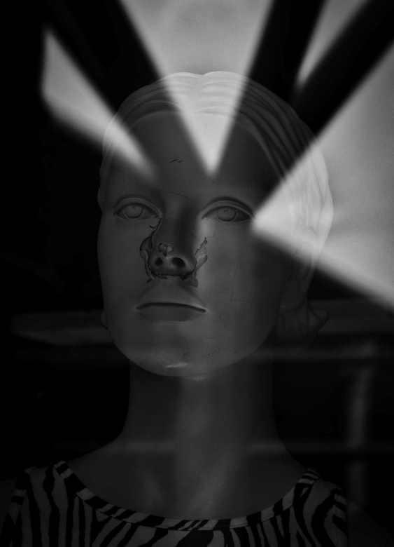 Ray of Light - Ik sta voor een etalage en fotografeer de reflecties.<br /> <br /> <br /> <br /> Bedankt voor alle reakties op m.n vorige foto. Gr.