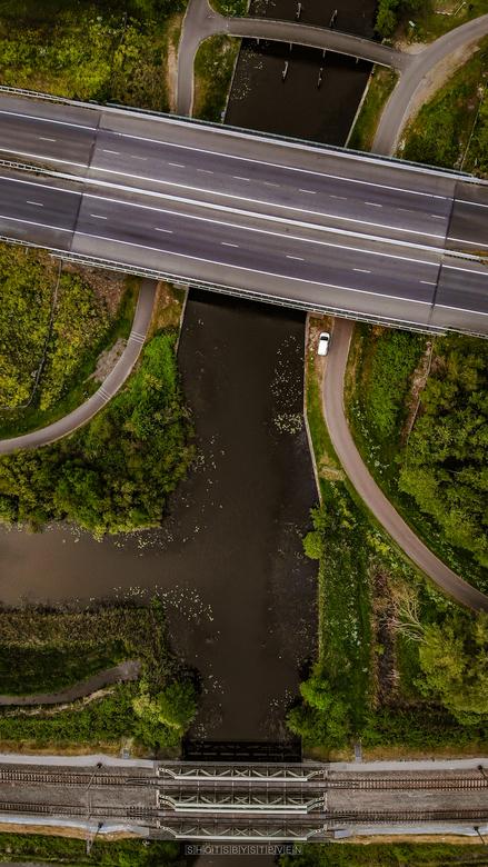 trein auto fiets brug - Bruggen over het water