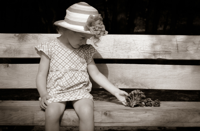 Girl on the wooden bench