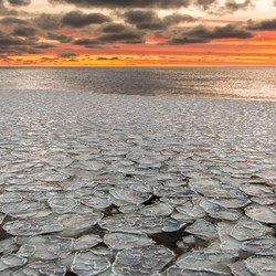 Pancake ice sunrice in Antarctica
