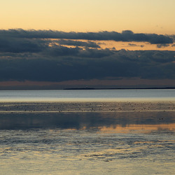 Het Wad na zonsondergang