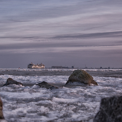 Ferry on the ice in the evening