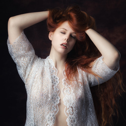 redhead in white blouse