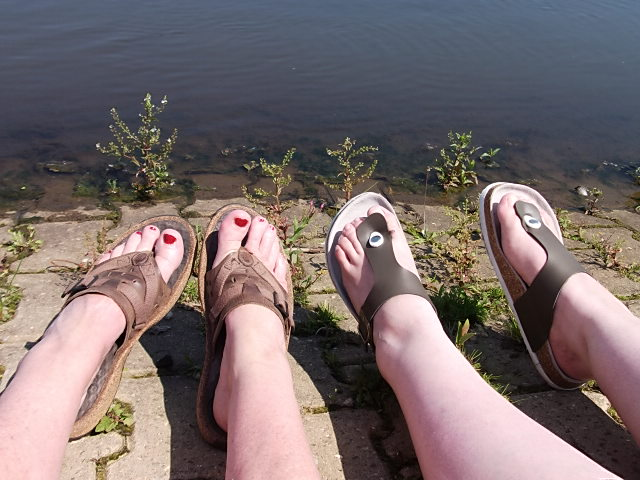 mommy and girl on waterfront - our feet