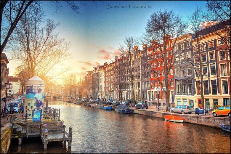 Amsterdam Sunset - Plaatje van Amsterdam tegen zonsondergang.