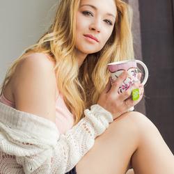 Blonde model holding mug