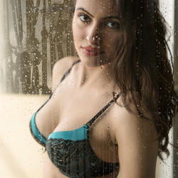 Ria behind wet glass