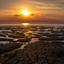 Zonsondergang bij de waddenzee