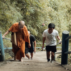 monk on his way to the top