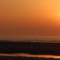 Zonsondergang aan de kust 8