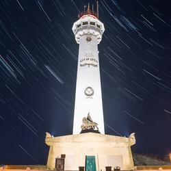 Stars above lighthouse