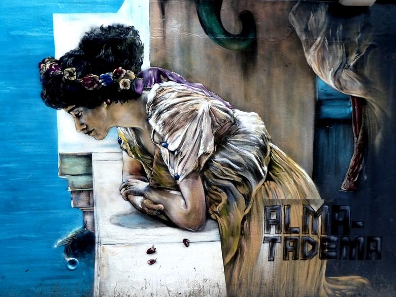 Alma Tadema - In een van de straten in `Leeuwarden vind je een mooi werk van Alma Tadema op de muur.<br /> <br /> Alma-Tadema was de meest succesvol