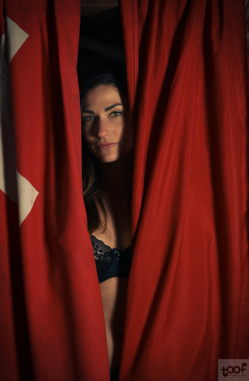 Behind red curtains..