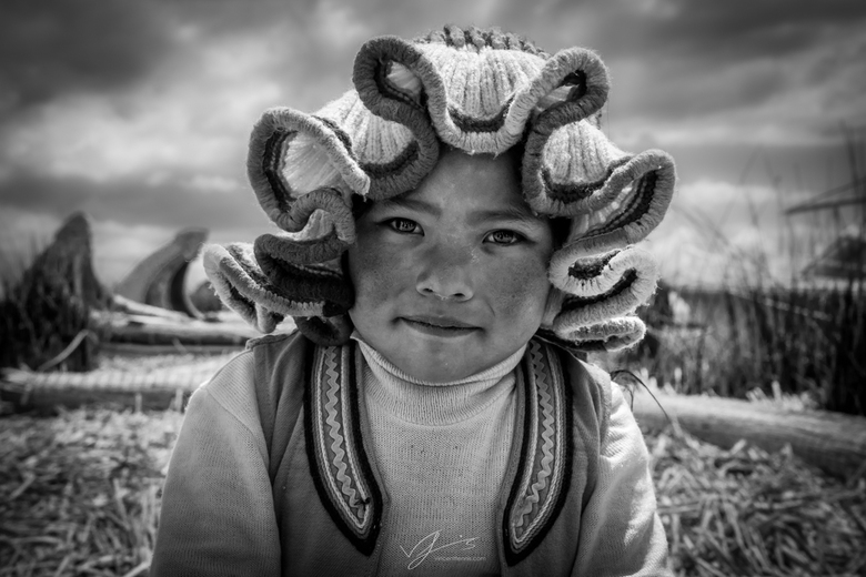 The girl from Lake Titicaca - Tijdens mijn rondreis door Peru ben ik heel wat mooie en fotogenieke mensen tegengekomen. Toen kwam ik dit jonge meisje