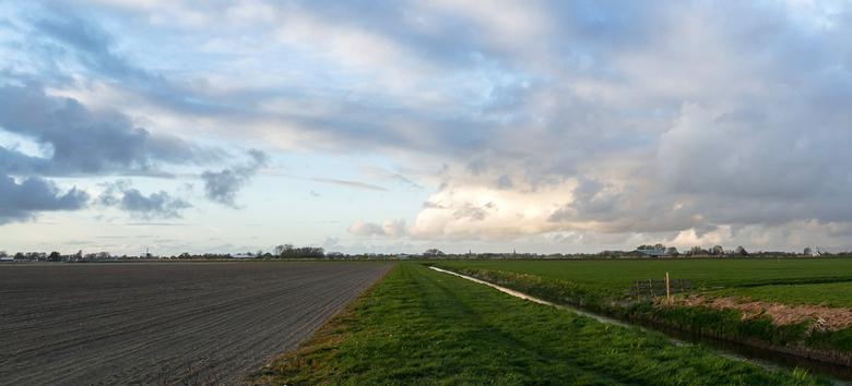 Landschap - Een stukje Noord Holland Noord. In de verte ligt Schagen