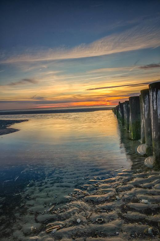 Sunset Ameland - Alweer een prachtige zonsondergang op het strand van Ameland.