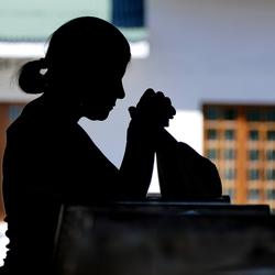 Vrouw in gebed