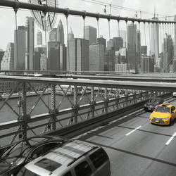 Yellow taxi on Brooklyn bridge