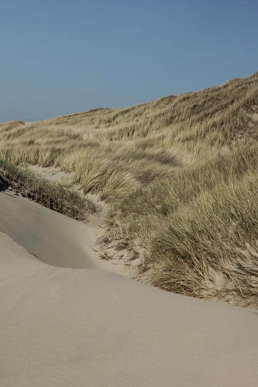 onaangeraakt zand -
