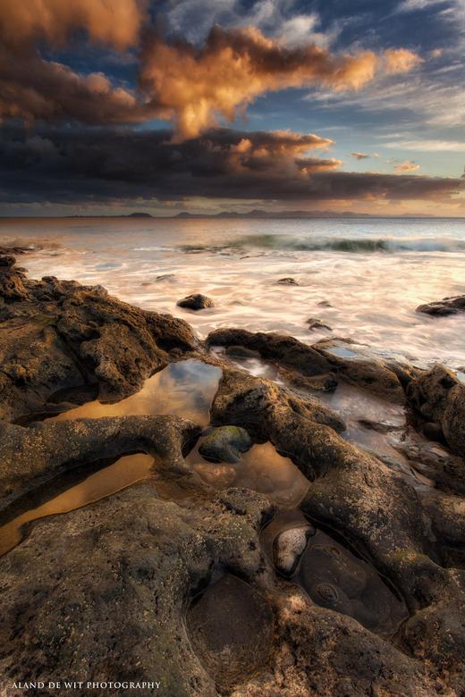 Water on the moon? - Zonsondergang aan de kust Playa Blanca Lanzarote.
