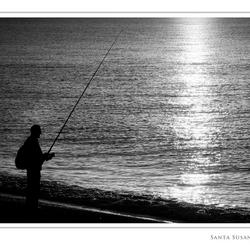 Visser bij zonsopkomst
