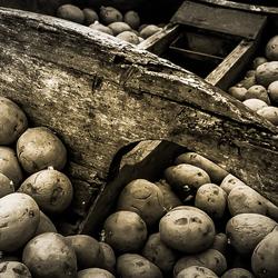 Oude aardappelpoot machine