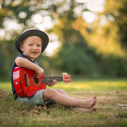 Playing the guitar just like his grandpa!