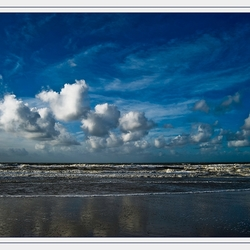 Strand, Zee en Wolken
