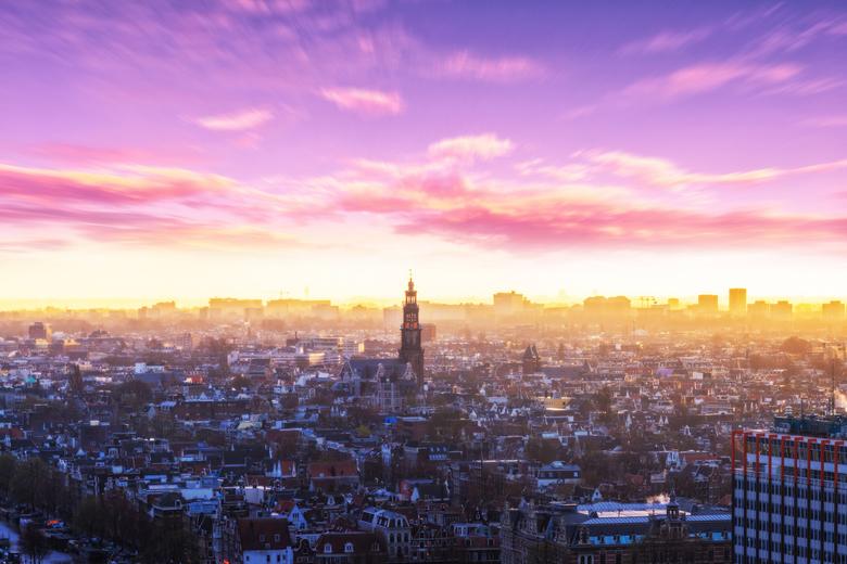 Amsterdam vanaf de Amsterdam Lookout - Foto van Amsterdam tijdens zonsondergang genomen vanaf de Amsterdam Lookout