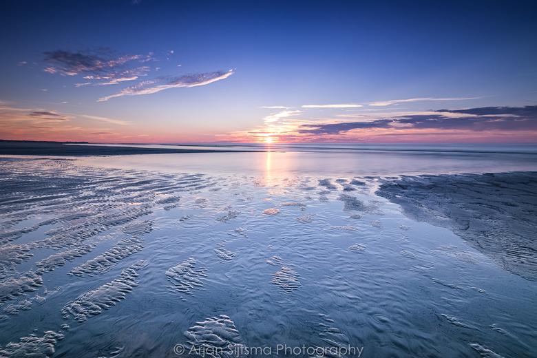 Opkomend water aan het Noordzeestrand
