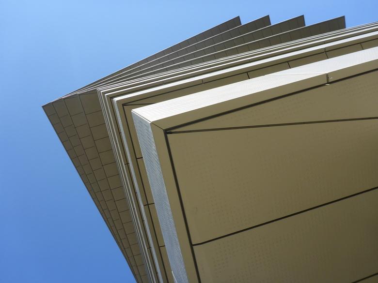 OMhoog - Geschrankte verdiepingen van een appartementsgebouw