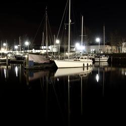 Weerspiegeling boot in het water