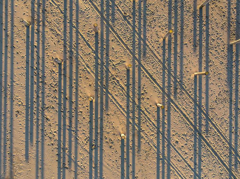Shadows on the beach  - Lange schaduwen van het Palendorp in Petten bij Zonsondergang