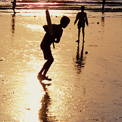 Cricket in India on the beach
