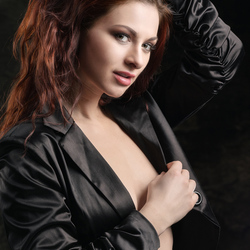 redhead in black jacket