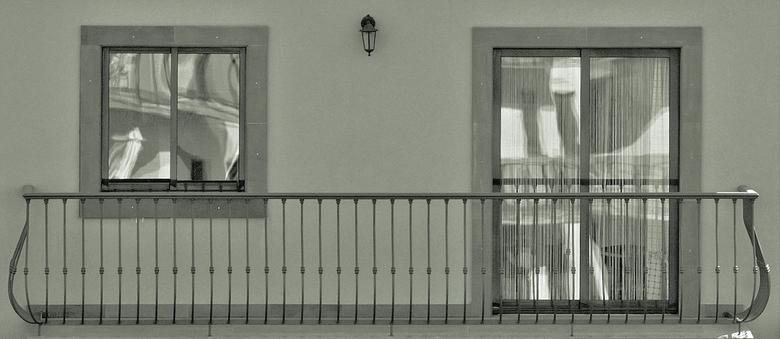 Balcon - Gespiegeld glas.