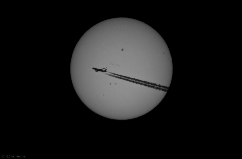 Sunspots &amp; Airplane - Canon EOS 7D + Celestron C90 1000mm f11.<br />
