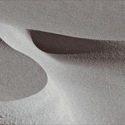 de wind speelt met zand 14