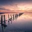 Kleurrijke zonsondergang aan het wad