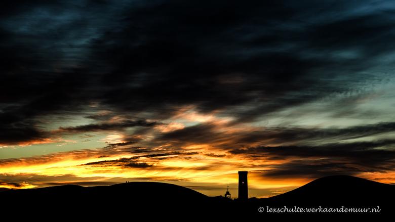 Rubjerg Knude Fyr - Silhouet van de vuurtoren van Rubjerg Knude. Deze staat in een wandelend duin en is dus al enige tijd verlaten. Onlangs zijn ze be
